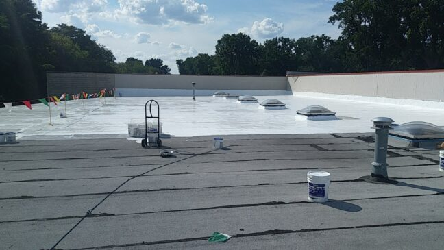 roof coating in process